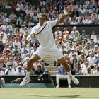 Jo-Wilfried Tsonga returns a backhand shot to Novak Djokovic.