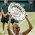 Petra Kvitova lifts the Venus Rosewater Dish after defeating Maria Sharapova in Saturday's women's final.