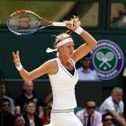 Petra Kvitova of the Czech Republic returns to Russia's Maria Sharapova during Saturday's women's singles final at Wimbledon.