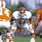 A September showdown between No. 1 Oklahoma and No. 2 Miami pitted Hurricanes QB Vinny Testaverde against Sooners linebacker Brian Bosworth. The Boz finished with 14 tackles, but it wasn't enough. Testaverde, in his Heisman Trophy-winning season, completed 21-of-28 passes (including 14 in a row) for 261 yards and four touchdowns in Miami's 28-16 victory. Miami went on to an undefeated regular season but then lost another No. 1 vs. No. 2 clash when it was upset by Penn State in the 1987 Fiesta Bowl.