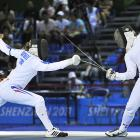 University of Notre Dame's Courtney Hurley (right) fences against France's Marie Fayolle in the women's epee team final. France defeated US 45-39 to win the gold medal.