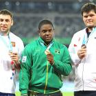 Mason Finley of the University of Kansas (right) shows off his bronze medal from the men's shot put event.