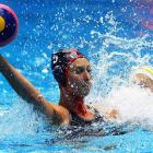 University of Southern California's Forel Davies (L) controls the ball during a women's water polo against Australia, which the United States won 8-6.