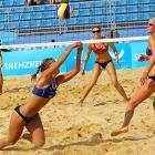 Loyola Marymount University's Heather Hughes and Emily Day (both in red) hover on defense in a match against Estonia.