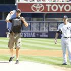 Roddick throws out the ceremonial first pitch before a Rangers-Yankees game.