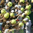 Roddick gives autographs after winning his third-round match against Thomas Johansson at the U.S. Open.