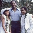 """Cowboys defensive end Ed """"Too Tall"""" Jones stands between teammate Tony Dorsett and Julie Simon on the couple's wedding day. The romance didn't last long as the couple divorced four years later."""