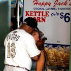 """Proof that a man can have his brew and a woman, too. According to the caption that accompanied the photo, """"A couple discovers the romance of baseball prior to the game between the Houston Astros and Brewers at Miller Park in Milwaukee."""""""