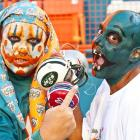 One of these rather colorful characters got the point while their beloved Fish went through the practice paces at Sun-Life Stadium in Miami.