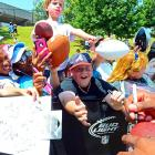A gaggle of ruddy-faced urchins was overcome by unbridled enthusiasm as rookie quarterback Cam Newton attempted to distribute his signature in Spartanburg, SC.