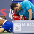 We're a tad squeamish about venturing a guess as to what exactly is going on here, but it appears to be some kind of extraction procedure during a medical time out at the Rogers Cup tennis tournament in Montreal.