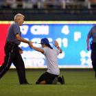 It's never a good idea to run onto the field at Kauffman Stadium during a game and look for coins that have fallen out of the players' pockets. The cops tend to take exception...