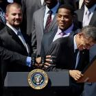Given the psychedelic pandemonium on Wall Street, it's easy to see why the Prez got a hearty horselaugh out of being presented with a stock certificate by Charles Woodson of the Super Bowl champion Green Bay Packers on the South Lawn of the White House, which is, as far we know, in Washington DC.