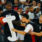 A security guard restrains a fan who tried to deliver a rather disconcerting personal message to the King during an exhibition game at Shanghai Stadium in -- where else? -- Shanghai.