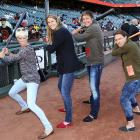 Diamondbacks, beware! Struggling in their defense of the World Series title, the San Francisco Giants appear to have revamped the heart of their lineup with (left to right) soccer stars Megan Rapinoe, Marian Dalmy, Abby Wambach and Sarah Huffman.