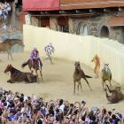 "That's Italian for ""famous breakneck bareback horse race"" around Piazza del Campo, Siena, Italy's main square. The annual event pits neighborhoods against each other and is a major draw for tourists who aren't satisfied with auto racing's usual carnage."