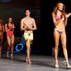 And here you thought we've been standing on our pointed heads to establish some kind of specious connection between skimpy, titillating swimwear and actual sports. Well, check out Australia's Eamon Sullivan (center) revealing what the well-dressed Olympic swimmer will be wearing in London next year.