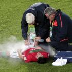 Portugal's Cedric apparently overheated, caught fire and had to be put out on the field during his team's final match against Brazil in Bogota.