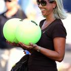 "We don't mean to implant inappropriate thoughts in your head, so we're sticking with the official notes that say this shot is of a woman ""having some fun with giant tennis balls at the Western & Southern Open at the Linder Family Tennis Center in Mason, Ohio."""