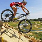 With the Olympics now less than a year away, test events were held. Here, Catherine Pendrel of Canada tries out the cross country mountain biking course.