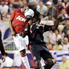 Manchester United midfielder Anderson goes up for a header against Sean Franklin of the MLS All-Star team.