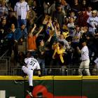 Seattle Mariners right fielder Ichiro Suzuki chases a home run ball hit by Boston Red Sox center fielder Jacoby Ellsbury (not pictured) up the wall and almost into the stands during the sixth inning in Seattle. The home run proved to be the difference in the Red Sox's 5-4 victory.