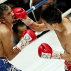 Defending champion Ioka Kazuto of Japan (right) smashes Juan Hernandez of Mexico during their WBC strawweight title match in Tokyo.