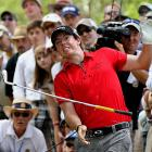 Northern Ireland's Rory McIlroy jumps back in surprise as he realizes his golf club has a snake on it. Not really. Actually, he's just grimacing in pain after injuring his wrist while hitting a tree root during a shot at the 93rd PGA Championship.