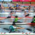 Competitors paddle in a heat of the K4 500m race of the Flatwater Kayaking and Canoeing World Championships in Szeged, Hungary.