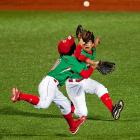 Sebastian Pacheco and Gerardo Duarte of Mexico collide while going after a fly ball during their game against Japan in the Cal Ripken World Series for the Babe Ruth League in Aberdeen, Maryland.