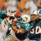 Miami Dolphins cornerback Benny Sapp (27) seems to be taking the name football literally.