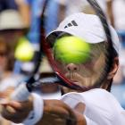 Spain's Fernando Verdasco keeps his eyes on the ball while playing compatriot Rafael Nadal at the Western & Southern Open tennis tournament.