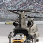 Astronaut Doug Hurley pilots the pace car out of a Chinook helicopter before the Dickies 500 at Texas on Nov. 8, 2009.
