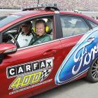 Michigan State basketball coach Tom Izzo can hardly contain his excitement prior to the Carfax 400 at Michigan on Aug. 15, 2010.