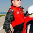 Will Ferrell, or should I say  Ricky Bobby , slides into the pace car before a practice session for the USG Sheetrock 400 on July 8, 2006.