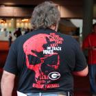A Georgia fan wears his allegiance subtly.
