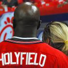 Evander Holyfield takes in the pregame spectacle at the Georgia Dome.