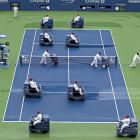 With rain putting a halt to the competition, court workers on blower machines kept soggy and increasingly surly spectators enthralled by re-enacting the classic video game Pac-man.
