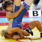 Mongolia's Davaasukh Otgontsetseg (in red) attempted to turn Russia's Zamira Rakhmanova into a fencepost during the women's 51kg freestyle gold medal match in Istanbul, not Constantinople. Somehow, Rakhmanova rose again to win the valuable first prize and become the envy of her neighborhood.