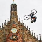 The generally expected result of trying to scale Nuremberg's Frauenkirche church on a bicycle.