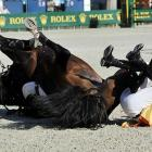 Two contestants enjoy a good horse laugh at the European Show Jumping Championships in Madrid.