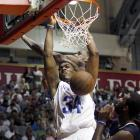 Kings center and Philadelphia native Jason Thompson dunks after evading LeBron James' attempt at a block.