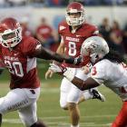 Tyler Wilson threw for 259 yards and a touchdown and Ronnie Wingo Jr. (left) accounted for 88 yards as the Razorbacks (2-0) outgained the Lobos 641-255. The Hogs' Marquel Wade returned a kickoff 85 yards for a touchdown, the team's third special teams' score of the season. Arkansas plays host to Troy next Saturday night before traveling to Tuscaloosa Sept. 24.