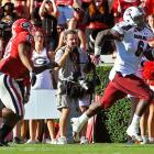 Welcome to the big leagues, Jadeveon Clowney. The freshman defensive end and nation's No. 1 recruit made his presence felt in a big way on Saturday, sacking Georgia quarterback Aaron Murray and forcing a fumble that the Gamecocks returned for the decisive touchdown. It was a big day for the Georgia offense, but South Carolina scored twice off turnovers. With Georgia starting 0-2, Mark Richt's job security becomes shakier by the day.
