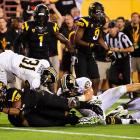 First Arizona State made a statement with its all-black uniforms. Then the Sun Devils made a statement with their play. Brock Osweiler and Co. built a 30-16 lead on Black Out night, but James Franklin (319 yards passing, 84 yards rushing, two TDs) put Missouri on his back and forced overtime. ASU got the ball first, and Osweiler found Jamal Miles (pictured) for an 11-yard score. The Tigers couldn't answer.