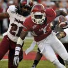 The Razorbacks improved to 3-0 thanks largely to the efforts of Ronnie Wingo, who rushed for a career-high 109 yards against Troy. Wingo's performance helped Arkansas make up for the absence of three senior starters.