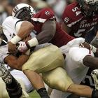 Marcus Lattimore ran for a career-high 246 yards enroute to the Gamecocks narrow 24-21 win over Navy Saturday. The standout running back carried the ball 37 times and helped thwart Navy's quest for its biggest upset since beating an undefeated Gamecocks squad 38-21 in Nov. 1984.
