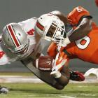 Miami quarterback Jacory Harris threw two first-quarter touchdown passes to help the Hurricanes jump out early against the No. 17 Buckeyes. Miami outgained Ohio State 363 yards to 209 on offense.