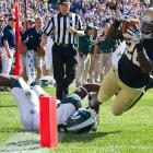 Notre Dame is finally in the win column. The Irish didn't cure their turnover bug, losing one interception and two fumbles, but they were able to overcome mistakes against the Spartans thanks to efficient offense and sound special teams play. Running back Cierre Wood (pictured) did the bulk of the scoring, punching in two touchdowns on just 14 touches.