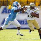 Georgia Tech continues to impress. The Yellow Jackets survived a close-fought battle with the Tar Heels thanks to another balanced effort from emerging star quarterback Tevin Washington (pictured), who rushed for 74 yards and two touchdowns in addition to completing 10-of-14 passes for 184 yards and a score. Tech is 4-0 for the first time since 1990.